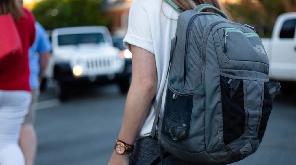 woman with gym bag backpack