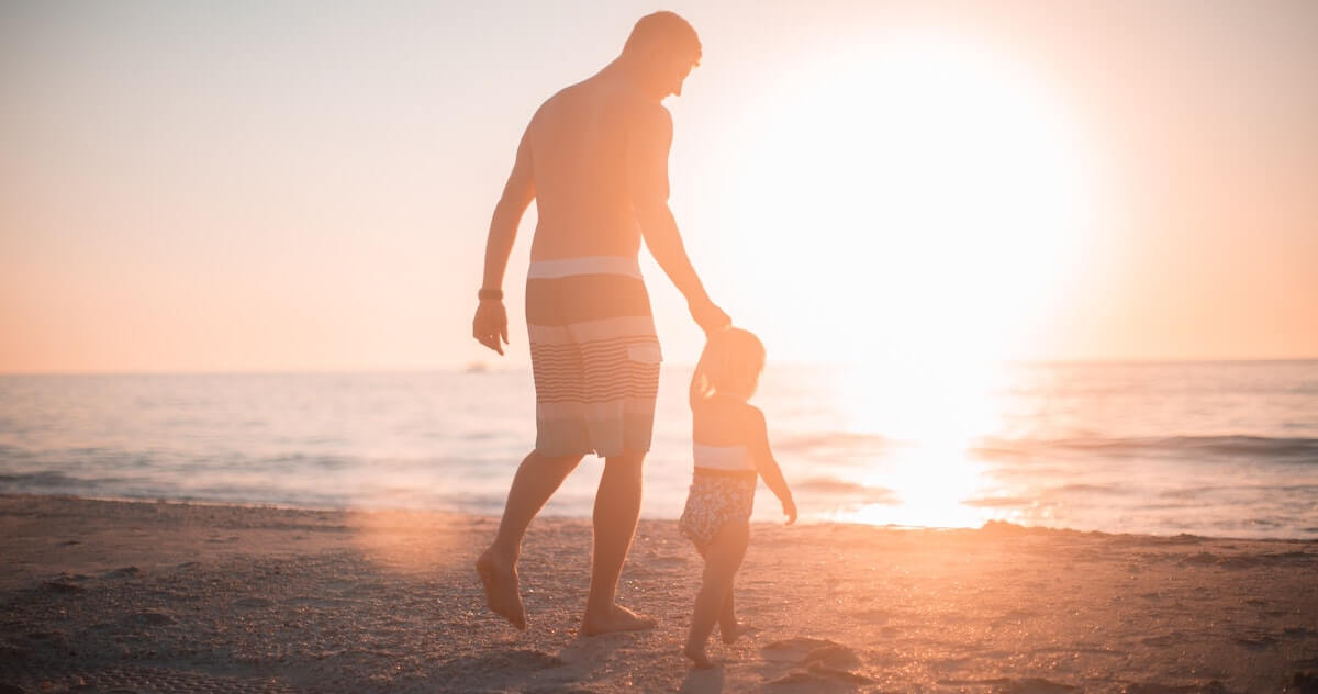 dad with little girl on a beach